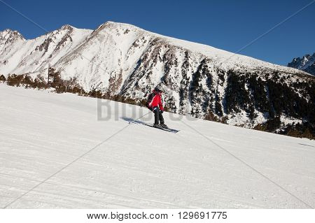 Concentrated skier descends from the mountain top