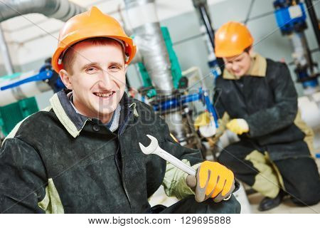 technicians of heating system in boiler room