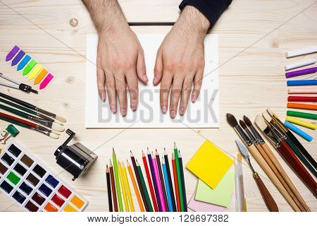 Man's Hands And Drawing Tools