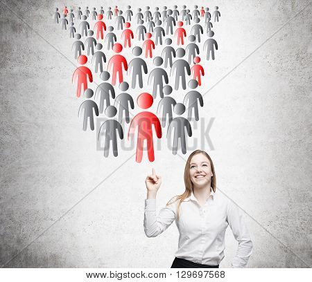 Lead generation concept with smiling businesswoman pointing at people icons