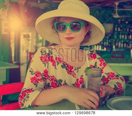 Young stylish beautiful woman in the bar