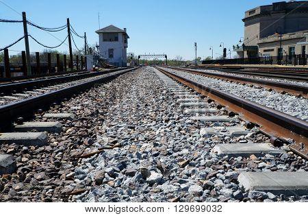 JOLIET, ILLINOIS / UNITED STATES - APRIL 26, 2015: Railroad tracks run past the Joliet Union Station in downtown Joliet.