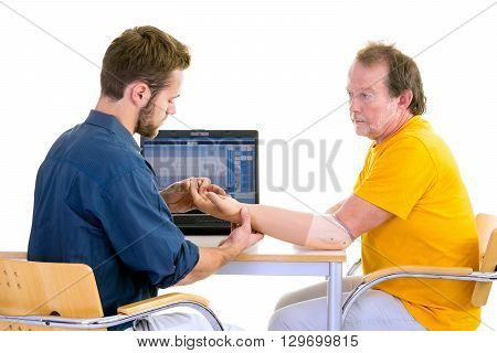 Medical Professional Works With Patient In Yellow. Testing Function Of Arm-prosthesis.
