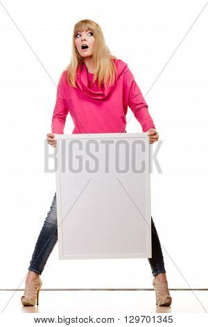 Advertisement and fashion concept. woman emotional face expression full body with blank presentation board. Isolated