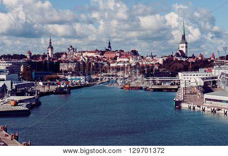 Vintage tinted snapshot of the Old Town and sea harbor in Tallinn, Estonia. Talinn sityscape
