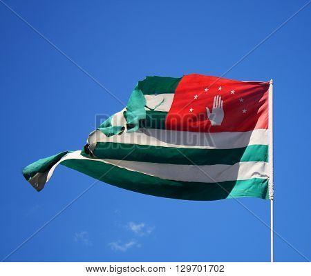 national flag of Abkhazia blue sky background