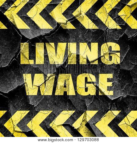 living wage, black and yellow rough hazard stripes