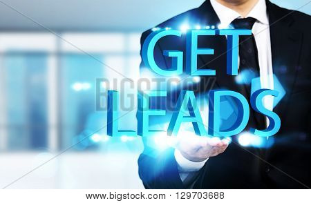 Get leads concept with businessman holding abstract writings