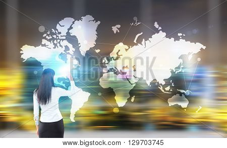 Traveling concept with businesswoman and abstract map on blurry city background