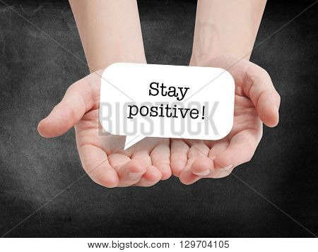 Stay positive written on a speechbubble