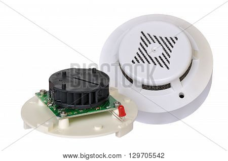 Smoke detector fire alarm with the cover removed on a white background