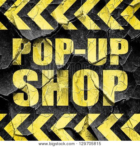 pop-up shop, black and yellow rough hazard stripes