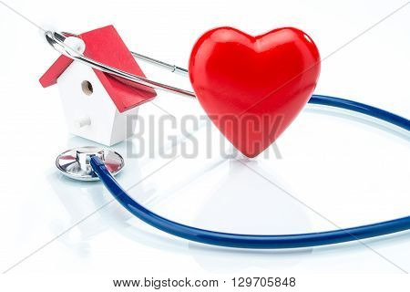 Family Care Concept, House Model And Heart Shape With Stethoscope