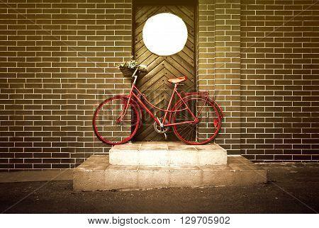 Vintage retro old red bike on the street. Bike and transportation.