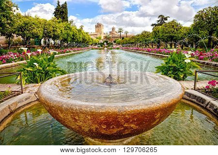 Close up of fountain in the famous gardens of Alcazar de los Reyes Cristianos, a medieval building located in the Andalusian city of Cordoba, Spain, near the Guadalquivir river and Mezquita.