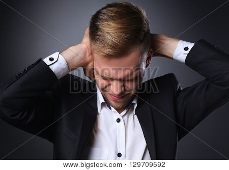 Man having head ache isolated on gray  background