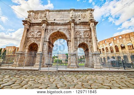 The spectacular Arch of Constantine, located between the Colosseum and the Arch of Titus on the Roman road, built to celebrate the triumph of the emperor Constantine. Rome, Lazio, Italy.