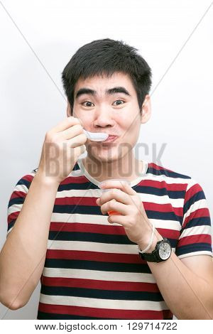 Man Eating Jelly Fruit On White