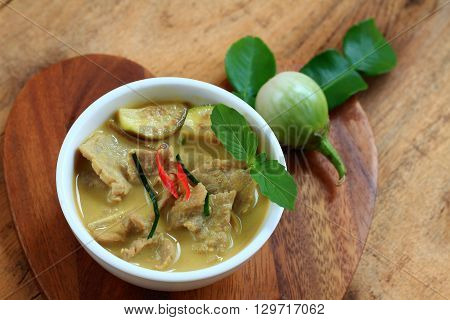 Pork green curry wood background is Thai food.