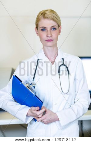 Portrait of woman vet bringing a clipboard at medical office