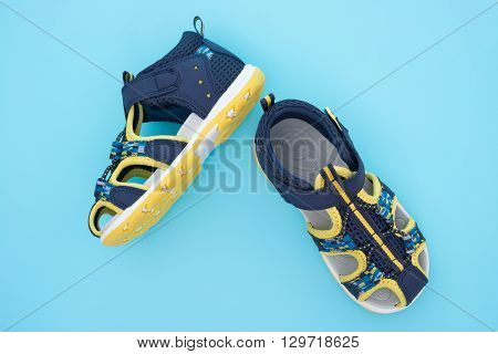 top view trendy sandal for boy on blue background