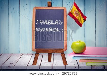 Digitally generated spain national flag against wooden planks