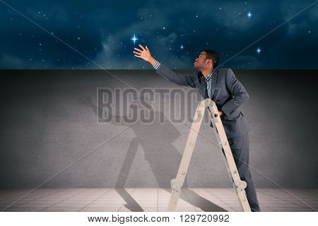 Businessman climbing up ladder against stars twinkling in night sky