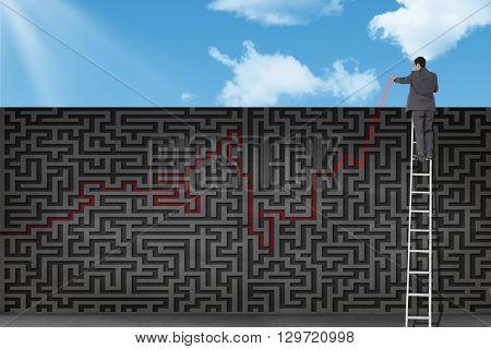 Businessman standing on ladder against grey maze