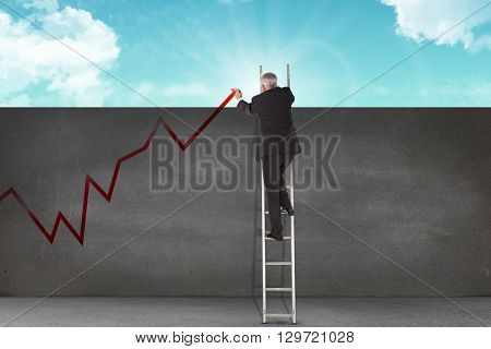 Mature businessman climbing career ladder against blue sky