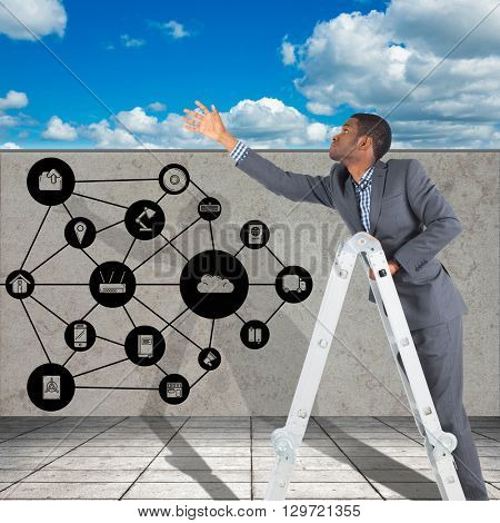 Businessman looking on a ladder against scenic view of blue sky