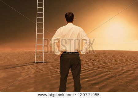 Rear view of classy young businessman posing against desert scene