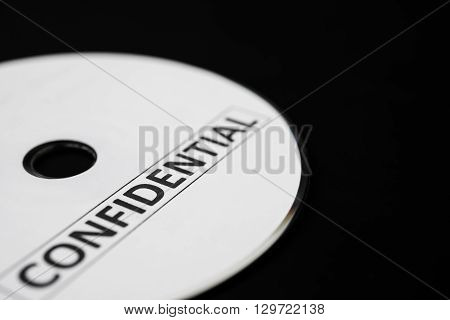 confidential cd on black with copy space