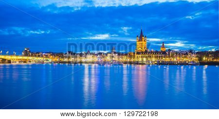 View of Cologne cityscape at night in Germany.