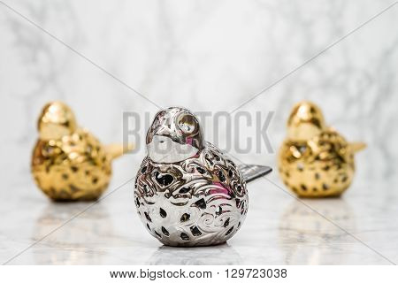 Statuettes Of Silver And Golden Birds