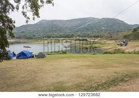 PHETCHABURY THAILAND - JANUARY 10: Tourist tent camping at Bang Krang Camp at Kaeng Krachan National Park on January 10 2015 in Phetchabury Thailand.