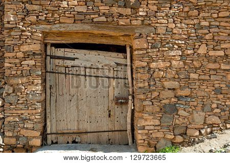 External view of a secured door of a grain store (Agadir) in south Morocco.