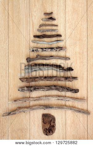 Abstract driftwood tree over oak wood background.