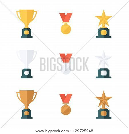 Set of gold, silver and bronze trophy cups, medals and star awards. Flat design vector illustration.