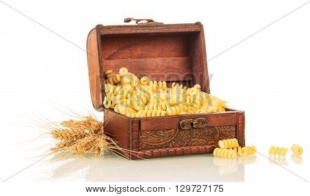 Pasta in the chest and ears of wheat isolated on white background