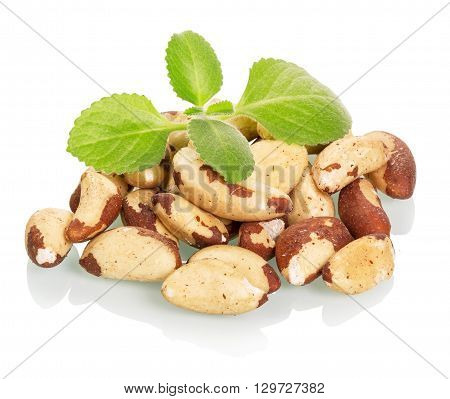 Brazil nuts and leaves isolated on white background