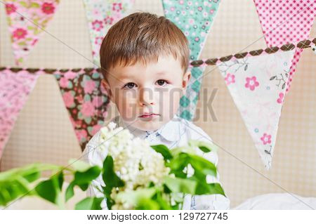 little boy with colorful flags on the background.