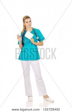 Female nurse holding gauze and hydrogen peroxide