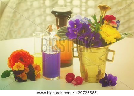 Flowers, mortar and bottles of potions, herbal medicine, retro toned