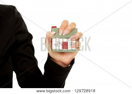 Model house is crushed in the woman hand