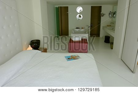 HERAKLION, CRETE, GREECE - MAY 13, 2014: The Interior room with big bed and bath in modern building of luxury class hotel on the Mediterranean coast of Crete, May 13, 2014, Greece.