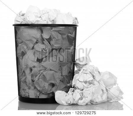 Basket overflowing with office paper isolated on white background