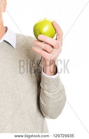 Close up on male hand holding an apple