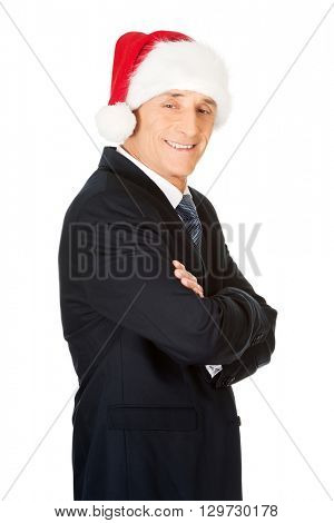 Side view man with folded arms wearing santa hat