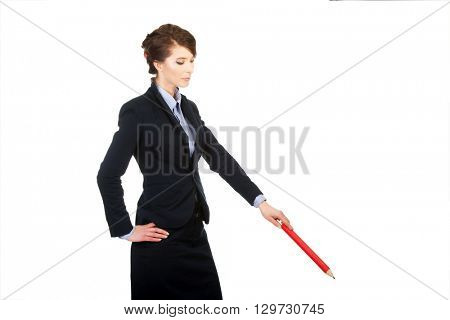Businesswoman pointing down with pencil.