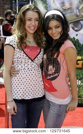 Miley Cyrus and Vanessa Anne Hudgens at the Los Angeles premiere of 'Over The Hedge' held at the Mann Village Theatre in Westwood, USA on April 30, 2006.